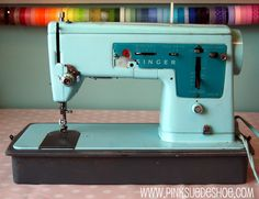 Turquoise Vintage Singer Sewing Machine..this reminds me of my mom's sewing machine, but hers is cream colored and in great shape!