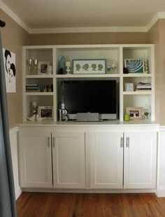 entertainment center...could take any old cabinet off Craigslist, Jonathan can build shelving, add paint
