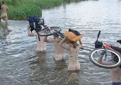 Cyclist carry cycles on head while crossing river #funny #bicycle