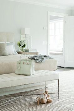 Pale blue green bedroom with white accents