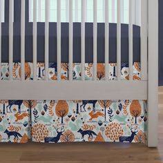 """Crib Dust Ruffle in Navy and Orange Woodland by Carousel Designs.  Think outside the box and get creative! Get your crib picture perfect with our box-pleat crib skirt. Finished length approximately 13-14 inches. Fits standard cribs using mattresses measuring approximately 28"""" x 52"""". Dry clean only."""
