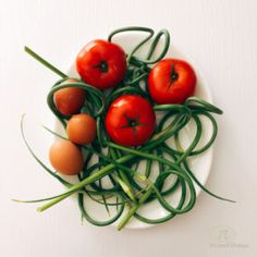 Tomato-Baked Egg topped with garlic scapes