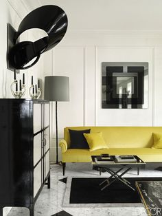 Bright accessories pop in this black and white living room.