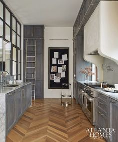 Grey kitchen with beautiful wood floor