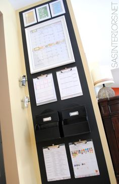 Chalkboard Family Central Command Center for the heart of the home including a monthly calendar, kids charts, inspirational quotes, and more.  Created by @Jenna_Burger via sasinteriors.net