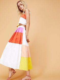 Pretty midi set featuring a simple boxy crop top and femme fit-and-flare skirt with a colorful, modern patchwork design.