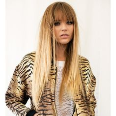 Long straight hair with blunt bangs. Pretty cut and style! It's hard to find bangs that work for fine hair.