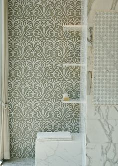 Artistic Tile The Vetromarmi Collection and Calacatta Gold adds a touch of elegance and and sophistication to this New York City bathroom.