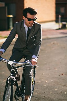 class // suit, grey, tie, pocketsquare, sunglasses, cycling