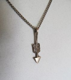 Arrow necklace.  Be couragous like Katniss from Hunger Games!