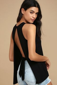 We can't stop singing the praises of the Impassioned Black Tank Top! Soft jersey knit shapes a rounded neckline and wide-cut, sleeveless bodice. Breezy open back with tying sash.