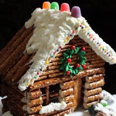 These pretzel cabins are a fun alternative to gingerbread houses. No baking required! Construct with pretzels and hot glue and decorate.