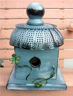 Birdhouse with a recycled vegetable steamer as a roof...cute!!