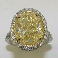 5.71 carat Oval Shape Fancy Yellow Diamond in Halo Diamond engagement ring http://www.bloomingbeautyring.com/colored-gemstones/