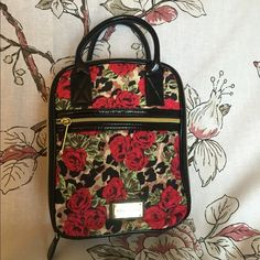 Lunch tote Leopard and roses. Make a statement with this Betsey Johnson lunch tote. Purchased with defects. Seam run shown in the nylon and punctures shown in the inner liner. Betsey Johnson Bags Totes