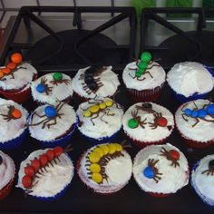 Halloween Cupcakes- use M and string licorice and they could make their own