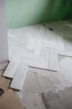 How long will the herringbone tile fad last? Cut down basic tiles for this Herringbone Marble Tile Master Bath Remodel, Home, Renovations, Bathroom Inspiration, Flooring, Bathrooms Remodel, Remodel, Bathroom Makeover, Tile Bathroom