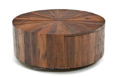 This organic coffee table highlights the wood's exceptional grain detail in a way that adds interest and movement to the piece's overall design. Graceful curves and rich tones lend refinement to this piece, while the hidden storage compartment (drawer) ensures this urban rustic coffee table is as fashionable as it is functional. Available in custom