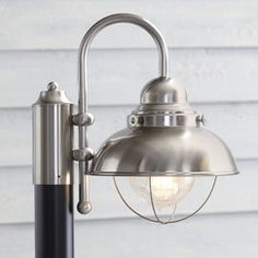 null This sleek outdoor light features a brushed stainless finish, sleek black metal base, and seeded glass for a contemporary take on traditional post lanterns. Lantern Set, Led Lantern, Outdoor Post Lights, Outdoor Lighting, Dock Lighting, House Lighting, Outdoor Ideas, Outdoor Spaces, Lighting Sale