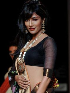 """Chitrangada Singh: Chitrangada looks absolutely stunning in a skimpy black blouse. The statement necklace adds character to the look. Aniket says, """"Sari blouses in bold and neutral shades such as gold, black and silver always stand out the best."""" These colours are versatile too."""
