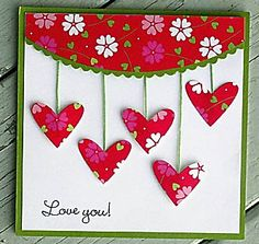 sweet handmade Valentine card ... five hanging hearts ... simple message ... luv the cheerful flower print paper for the heart and the scallop top ...