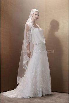 Pronuptia Paris robe de mariée tulle traîne chapelle sans manches application