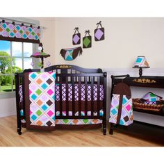 Create a colorful and streamlined look for your nursery with this wonderful 13-piece crib bedding set. This comprehensive ensemble includes everything you need to keep your baby comfortable and your decor fashionable. A toy bag provides storage space.