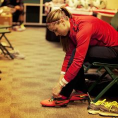 Alex Morgan lacing up her #Nike #Total90 Lasers before a #USWNT game.