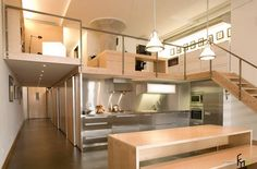 A Futuristic Kitchen Hallway With Glossy Stainless Kitchen Cabinet And Light Brown Kitchen Island With Perfect Lighting Wonderful Kitchen Hallway Design Ideas: Modern Kitchen Setting http://seekayem.com
