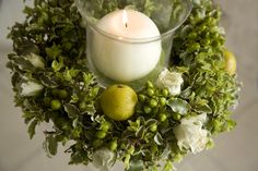 rustic wedding centerpiece with green foliage, roses and apples
