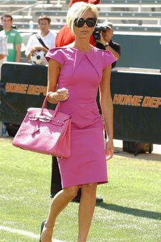 Victoria Beckham.. fuchsia RM by Roland Mouret dress, Hermes ostrich Birkin with Balenciaga heels..