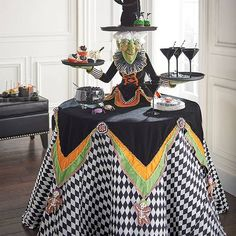Witch server Halloween party food serving table ideas
