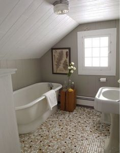 Small bathroom ideas - Home and Garden Design Idea's - sloped beadboard ceiling, soaker standalone tub, mosaic tile floor, pedestal sink