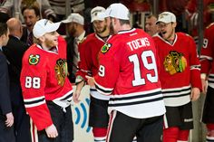 CHICAGO, IL - JUNE 8: Jonathan Toews #19 and Patrick Kane #88 of the Chicago Blackhawks celebrate and wear the Western Conference Champions hats, as teammates Niklas Hjalmarsson #4 and Andrew Shaw #65 stand in the background, after defeating the Los Angeles Kings to become the 2013 Western Conference Champions in Game Five of the Western Conference Final during the 2013 Stanley Cup Playoffs at the United Center on June 08, 2013 in Chicago, Illinois. (Photo by Bill Smith/NHLI via Getty…