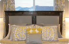 diy upholstered headboard...in front of window, looks good due to coordinated drapes.