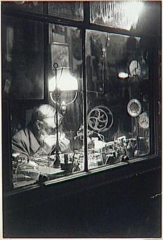 Brassaï - Horloger (Watchmaker), Rue Dauphine, ca. 1930-1932.