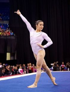 Aly Raisman holds a pose during her floor exercise routine during the finals of the 2012 Visa Championships, the qualifier for the USA Gymnastics Olympic Trials.  Raisman won the national title on the event.