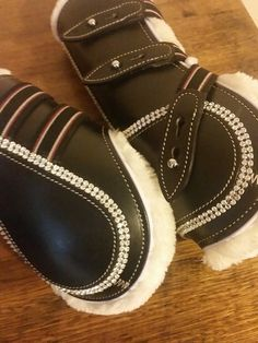 Our black bling tendon boots are the perfect touch to add to your ponies/horses show jumping attire and jump in style. These stunning black boots are lined with mink fur and each boot includes a double row of crystals, making sure each leg is protected in STYLE.