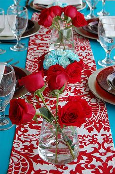 turquoise and red; runner from etsy; rented tablecloth; dyed carnations