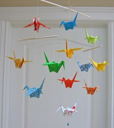 crane mobile for rainbow girls room. thread with beads to hold cranes and ribbon at the very top that secures to the ceiling. This would be fun to make!