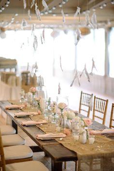hanging feather reception, photo by Sean Money + Elizabeth Fay http://ruffledblog.com/glittered-charleston-wedding #wedding #decor #rustic