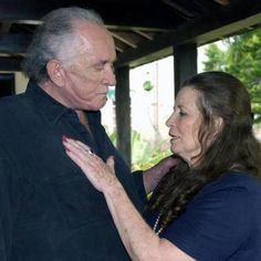 Johnny Cash & June Carter Cash......just goes to prove a that good woman with God's on her side can change any man