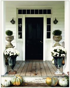 Beautiful entry way with white flowers! Outside color of door.