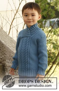 """Knitted DROPS jumper with cables, textured pattern and shawl collar in """"Merino Extra Fine"""". Size 3 to 12 years."""