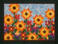 A Storm-at-sea quilt: Summerfest Garden, design by Joen Wolfrom, at Joen Wolfrom and JWD Publishing