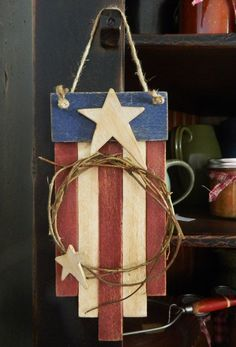 From the scrap barrel came this cute wooden flag adorned with honeysuckle vine wreath and wood stars.