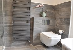 Luxury grey bathroom design with grey contemporary towel rail Contemporary Style Bathrooms, Contemporary Tile, Grey Bathrooms Designs, Guest Bathroom Remodel, Bad Styling, Guest Toilet, Interior Design Images, Toilet Design, Bathroom Styling