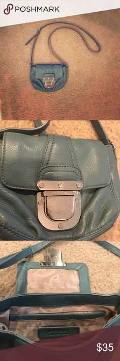 Michael Kors Crossbody Bag Small blue Michael Kors Crossbody. Perfect for a night out on the town. There is some normal wear and tear. There are a few scratch marks on the buckle (see close up picture). Other than that, it's a beautiful leather bag. Michael Kors Bags Crossbody Bags