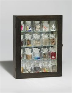 """""""Pharmacy"""" (1943) by Joseph Cornell, New York, Christie's via ArtNet    Joseph Cornell's Hirst-like """"Pharmacy,"""" 1943, as seen above, a box that once owned by Marcel Duchamp's wife sold for 3.7 million (with fees) after active bidding from four bidders wanted to take it home. This sale was well above its high estimate of two million and was an auction record for the artist."""