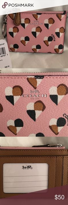 Authentic Coach Mini key chain. Authentic Coach ID and money holder. This is a key chain or you can simply put the key chain in the inside and use it in your purse or carry. It's sooo stinkin adorable! Pink with brown, tan and cream hearts. I need big, so as much as I can't get enough of these, I need a normal size wallet. This is a fun treat!! 💕 Coach Accessories Key & Card Holders